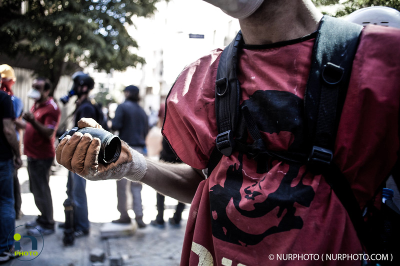 Intervention of the police force this afternoon in Taksim square. Police fired tear gas and water cannons in Taksim Square during the 11th day of anti-government protest in Istanbul, on June 11, 2013.  Photo: Michael Bunel/NurPhoto