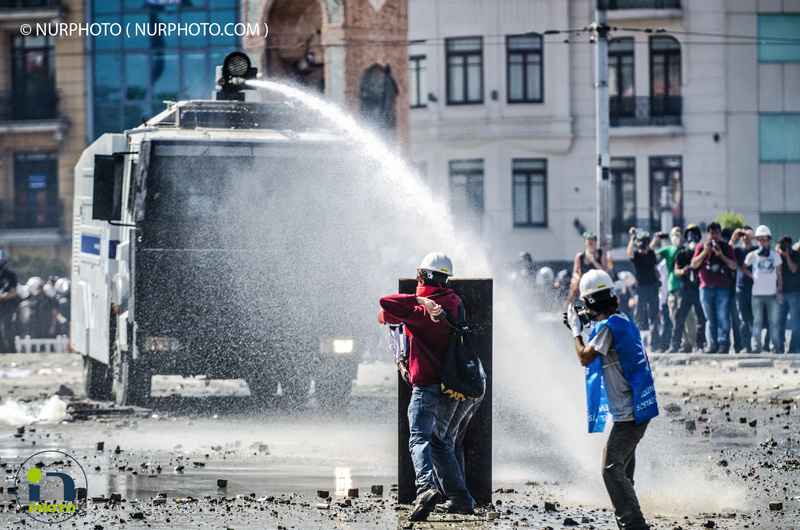 Clashes between police and protesters in Taksim Square. Police fired tear gas and water cannons in Taksim Square on June 11, 2013, the 11th day of anti-government protests in Turkey.  Photo: Kaan Saganak/NurPhoto