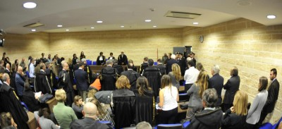 Judge Fabrizia Ida Francabandera, background, center, reads the appeal sentence clearing seven experts charged with failing to adequately warn residents of the risk before an earthquake struck central Italy in 2009, killing more than 300 people, in L'Aquila, Italy, Monday, Nov. 10, 2014. The appeal court in L'Aquila, the city struck by the quake, on Monday overturned guilty verdicts against the seven saying no crime had been committed. The convictions two years ago sent shockwaves through the scientific community, which argued that the charges represented a complete misunderstanding about the science behind earthquake probabilities. (AP Photo/Sandro Perozzi)